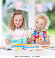 little boy draw together white stock photo 563741602