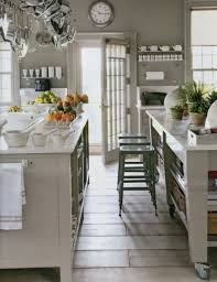 wall colors for kitchen white kitchen gray island black floral pattern marble countertop