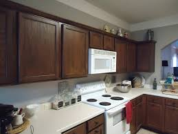 Painted Kitchen Cabinets Before And After by Painting Wood Kitchen Cabinets White Before And After Floor