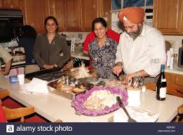 thanksgiving celebration by south asian ethnic family stock photo