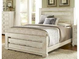 rustic bedroom furnished with distressed bed with nightstand and