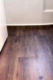 Bathroom Vinyl Flooring by Luxury Vinyl Plank On Stairs With White Risers Vinyl Floors