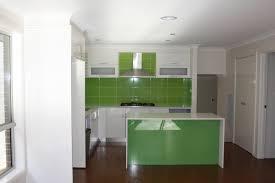 delectable green ceramic tiles backsplash of modern small kitchen