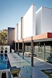 white contemporary house in australia with large beautiful windows
