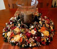 ideas for christmas centerpieces by brown candle on the glass