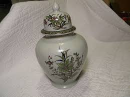 porcelain green ginger jar vase with birds appears to be hand