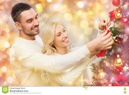 At Home Christmas Trees by Happy Couple Decorating Christmas Tree At Home Stock Photo Image