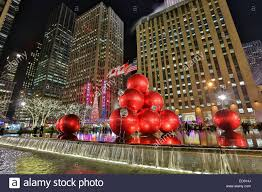 christmas decorations in front of the exxon building across from