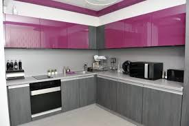 small purple kitchen appliances with white kitchen cabinet and two