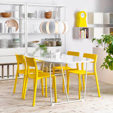 dining room furniture ideas dining table chairs ikea a dining room with an oval white dining table and yellow chairs shown together with