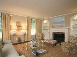 wooden cabinet beside stone fireplace mantel elegant chandelier