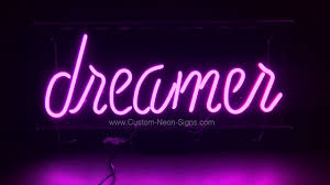 dreamer neon sign with script lettering in orchid pink neon visit