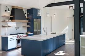 blue kitchen island and white cabinets photo 4 of 13 in how much should you spend on kitchen