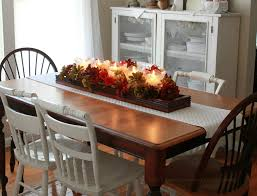 dining room centerpiece ideas colorful flower bouquet and candle with brown wooden tray on brown