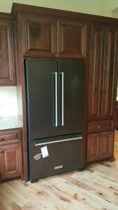 what color cabinets go well with black stainless steel appliances kitchenaid black stainless appliances with cherry cabinets