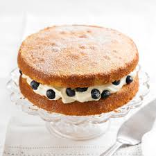 Victoria Sponge With Blueberries And Cream Cheese Icing Woman
