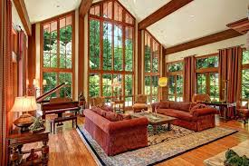 craftsman living room with high ceiling u0026 transom window in fall