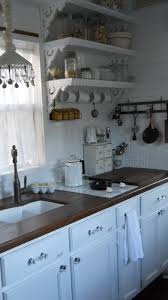 the kitchen inside the shabby chic tiny retreat tiny house