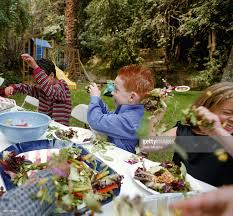 children in backyard throwing food at each other stock photo