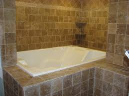 bathroom cozy bathtub with rain shower and nemo tile wall for