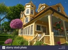 usa michigan lake huron mackinac island yellow house with purple