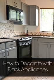 white kitchen cabinets decorating ideas black appliances and white or gray cabinets how to make it