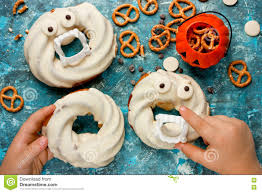 halloween teeth halloween donuts in white chocolate with teeth and eyes on blue