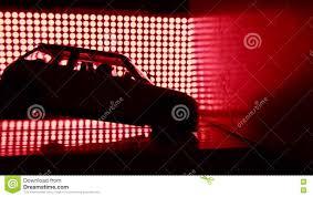 toy car crashing into wall crash test lab concept red lights