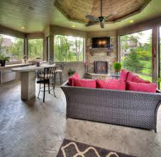 sunroom with fireplace mediterranean pink cushions contemporary