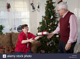 senior man giving christmas present to wife 60 65 year old man
