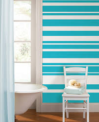 decorating black and orange round wallpops with white leather blue striped wallpops with white parsons chair and