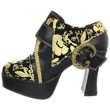gold print black platform shoes with buckle detail worn by whoopi
