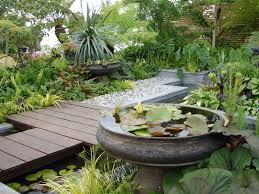 Very Small Backyard Landscaping Ideas by Very Small Backyard Garden Spaces With Ponds And Wooden Bridge