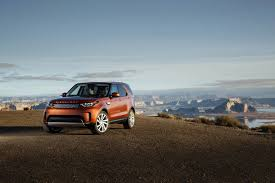orange range rover sleek land rover discovery articulates its purpose