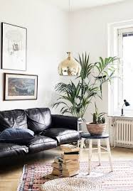 leather sofa living room mid century modern home with lots of green via cocolapinedesign