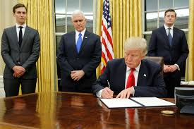 trump in oval office signs first order on obamacare hamodia