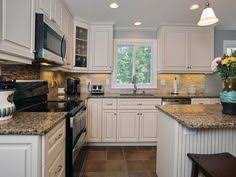 kitchens with white cabinets and black appliances white kitchen with black appliances design pictures remodel decor