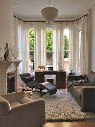 modern curtain rods living room eclectic with black leather lounge