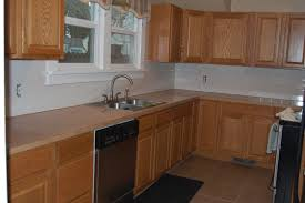 Kitchen Cabinet Restaining Staining Kitchen Cabinets Darker Before And After Monsterlune