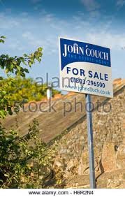 Uk Barn Conversions For Sale An Estate Agent For Sale Board Advertising A Rural Property And