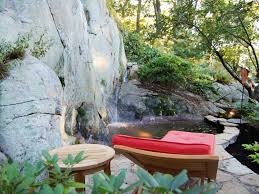 small tropical backyard ideas wooden lazy chair using red cushion for tropical landscaping ideas