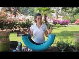 como hacer macetas con llantas recicladas paso a paso maceta con llanta en forma de flor youtube jardinage pinterest