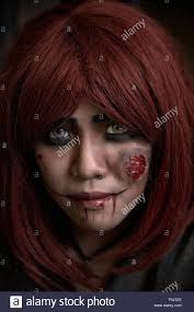 piercing eyes and face makeup of a female zombie or ghoul