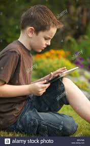 a 10 years boy using an in the garden stock photo