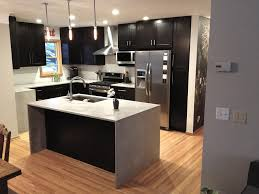 modern kitchen cabinets in island with waterfall countertop
