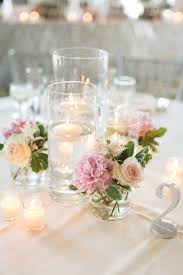 modern table numbers les fleurs floating candle centerpieces blush pink silver