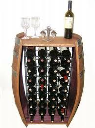 oak wine barrel gets a second chance as stunning wine rack green