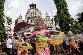 locals celebrate in one of bali s oldest christian