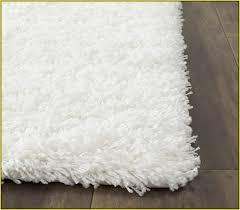 collection in white bathroom rugs bath gold scrollwork bath rug