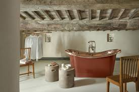 cottage interior design with tuscan style bathroom with copper